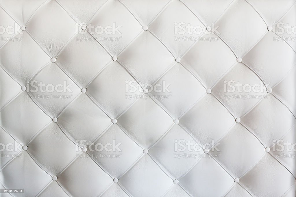 quilted leather sofa covering closeup stock photo