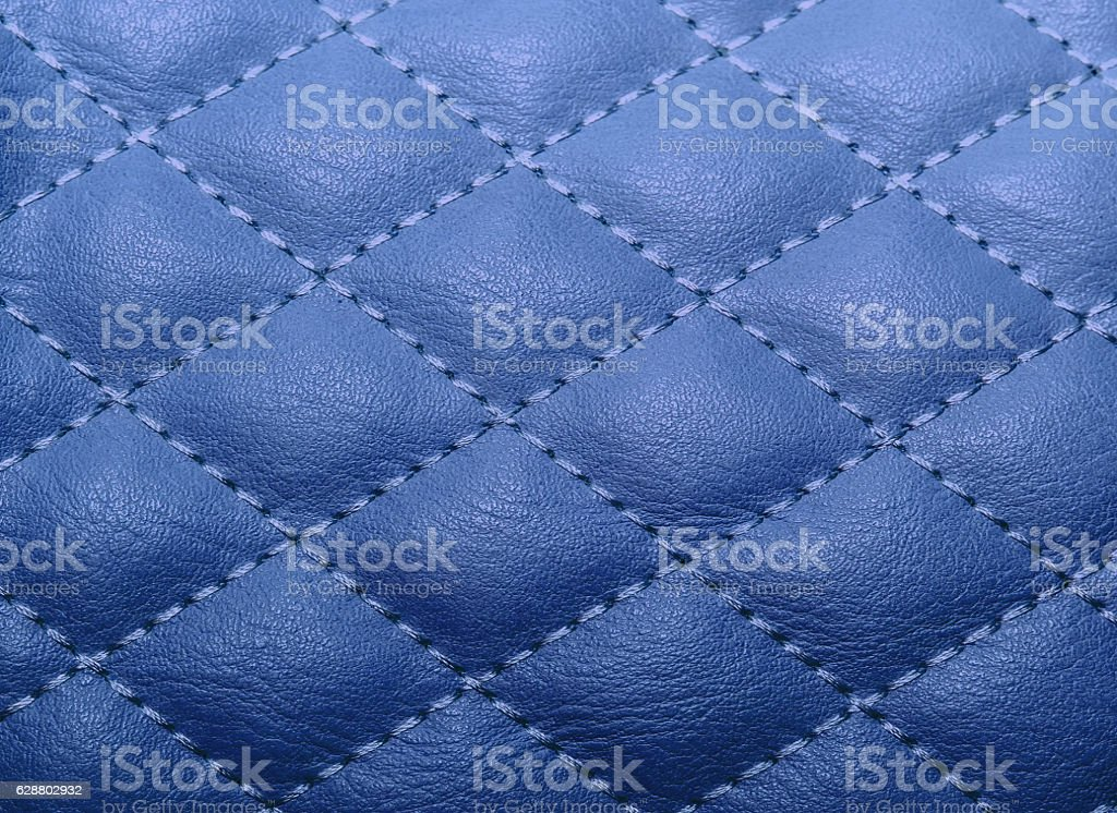 quilted texture artificial leather, stitched with thread for the stock photo
