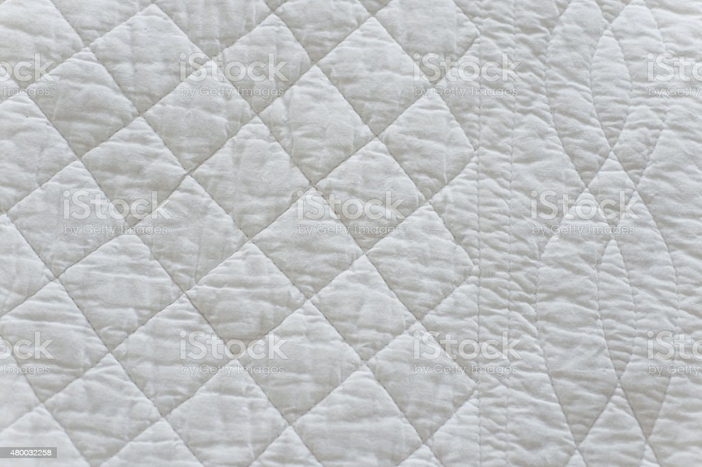 Quilted White Natural Textiles stock photo