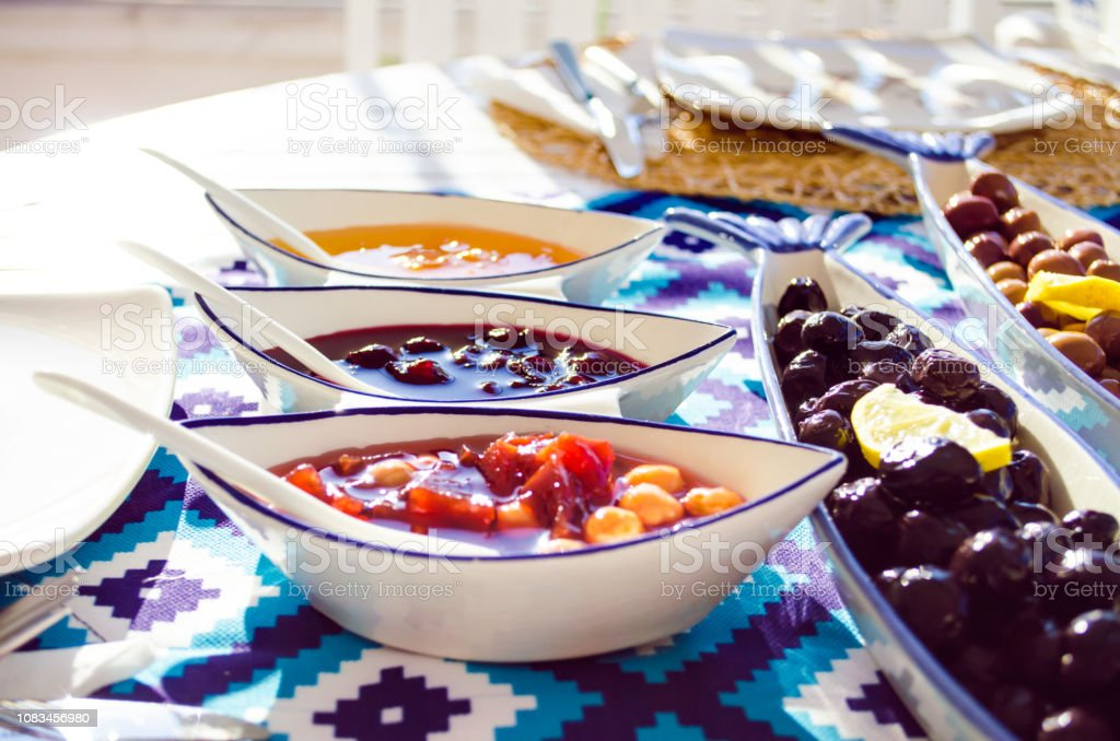 quince, cherry and apricot jams on breakfast table stock photo