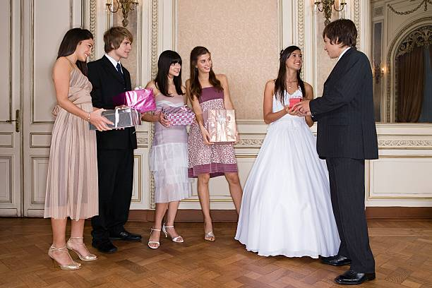 Quinceanera and friends  group of friends giving gifts to the birthday girl stock pictures, royalty-free photos & images