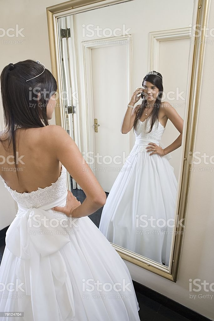 Quinceanera looking in mirror royalty-free 스톡 사진