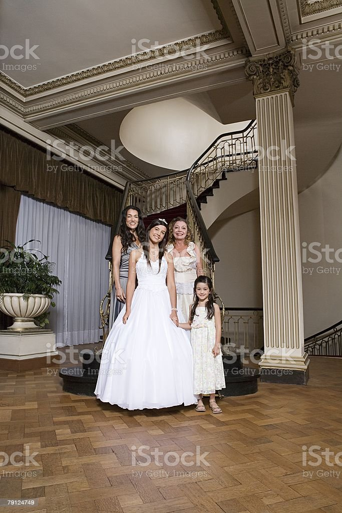 Quinceanera with her female relations royalty-free 스톡 사진