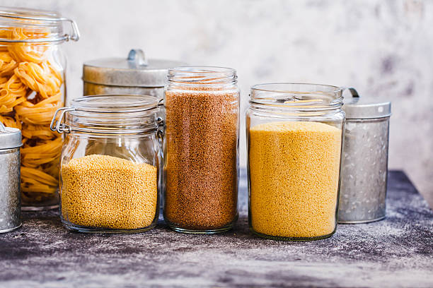 Quinoa And Various Couscous Cereal Over The Kitchen Table stock photo