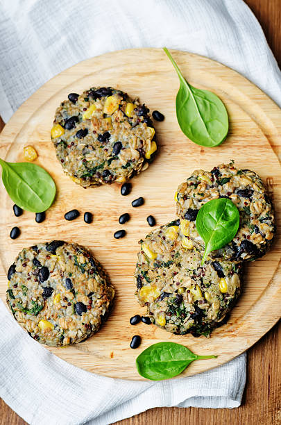 quinoa black bean spinach corn burgers stock photo
