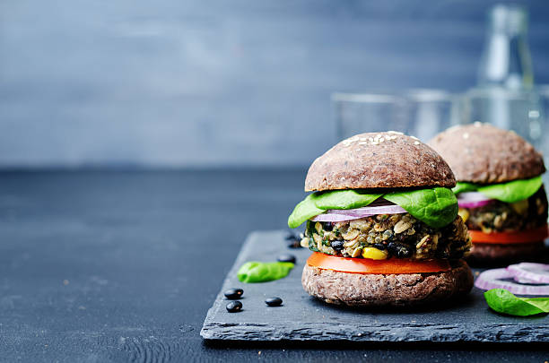 quinoa black bean spinach corn burgers with black beans bun crust stock photo