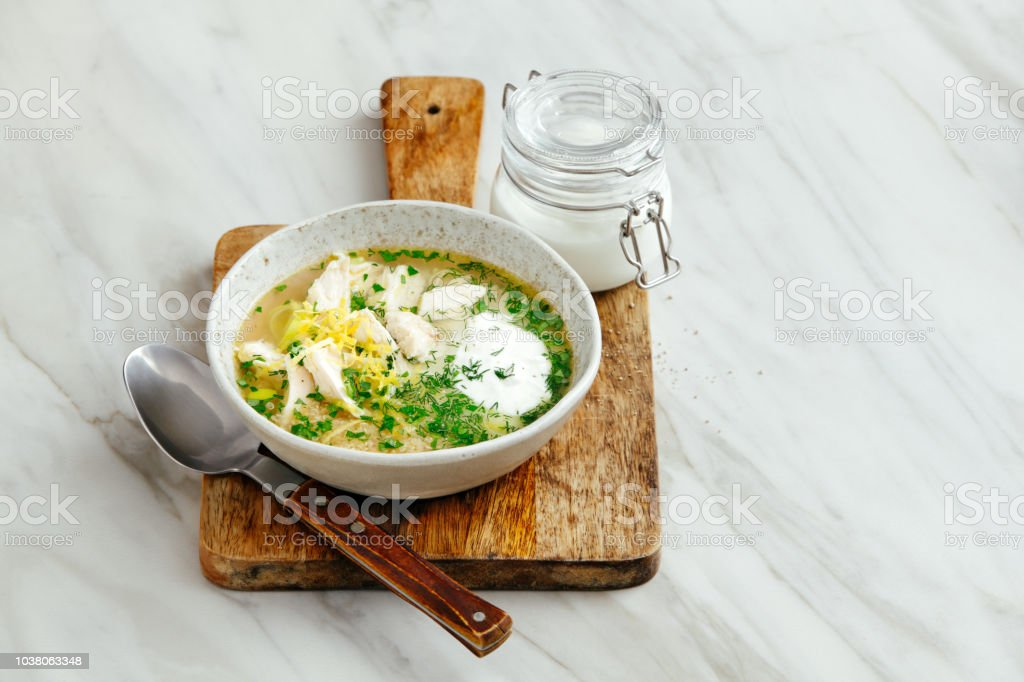 Quinoa chicken soup with herby lemon stock photo