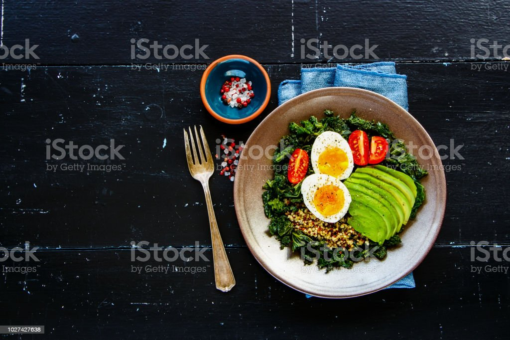 Quinoa, kale and egg bowl stock photo