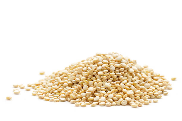 quinoa pile - quinoa stock photos and pictures