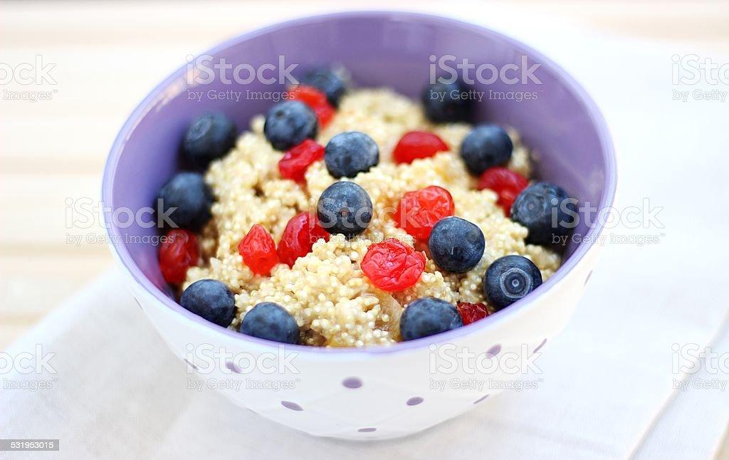 Quinoa porridge with berries stock photo