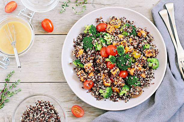 quinoa salad with broccoli,sweet potatoes and tomatoes - quinoa stock photos and pictures