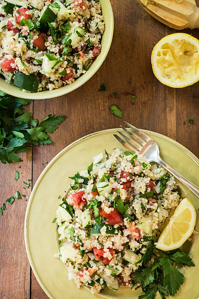 """Quinoa Salad with Cucumbers and Tomatoes From Above """"Quinoa salad with cucumbers, tomatoes, onion, and parsley drizzled with lemon juice viewed from above.Similar Images:"""" quinoa stock pictures, royalty-free photos & images"""