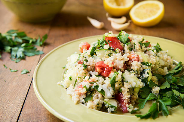 """Quinoa Salad with Cucumbers and Tomatoes Horizontal """"Salad made with quinoa, cucumber, tomato, onion, garlic and parsley drizzled with fresh lemon juice.Similar Images:"""" quinoa stock pictures, royalty-free photos & images"""