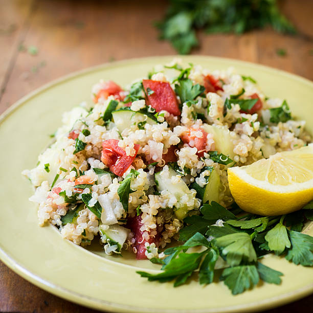 Quinoa Salad with Cucumbers and Tomatoes Square Salad made of quinoa, cucumber, tomato, onion, and parsley drizzled with fresh lemon juice. quinoa stock pictures, royalty-free photos & images