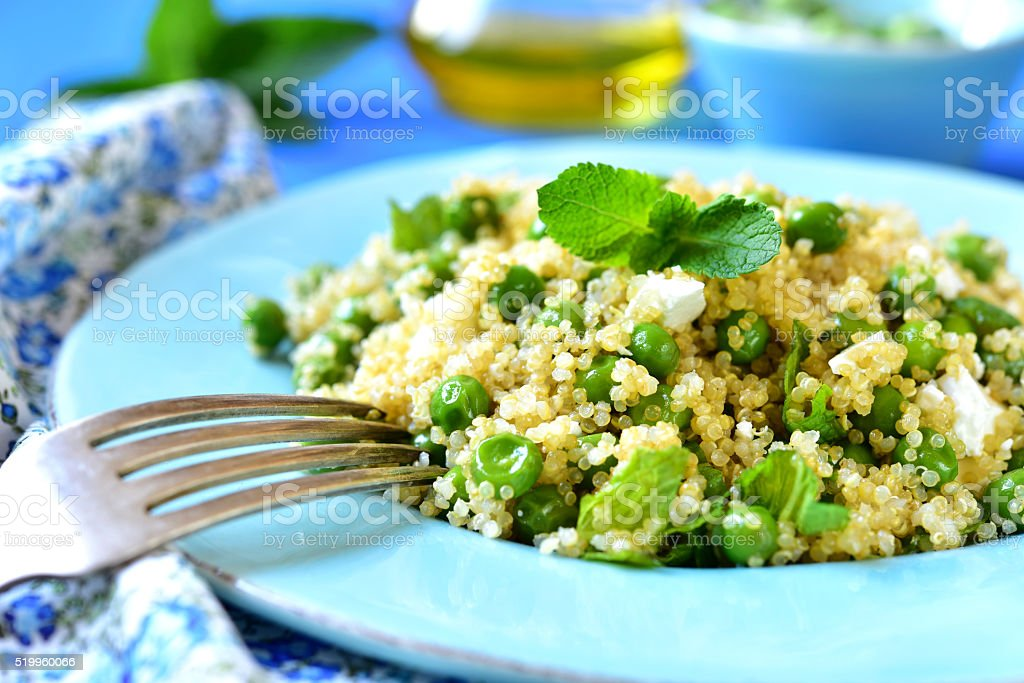 Quinoa salad with green pea,feta and mint. stock photo