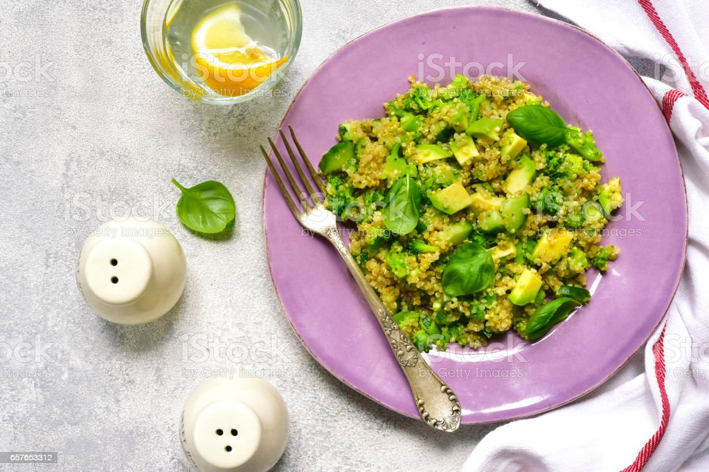 Quinoa salad with green vegetables stock photo