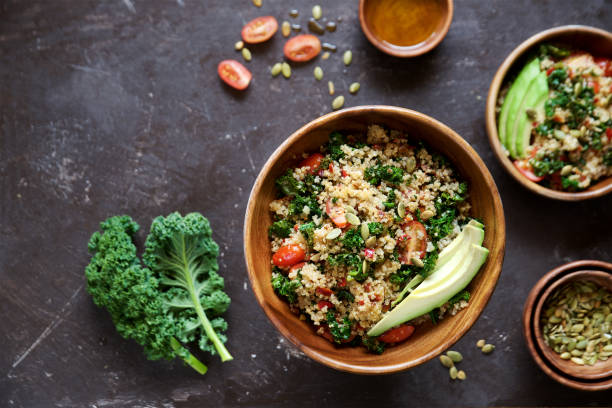 quinoa salad with kale, cherry tomatoes and pumpkin seeds - quinoa stock photos and pictures