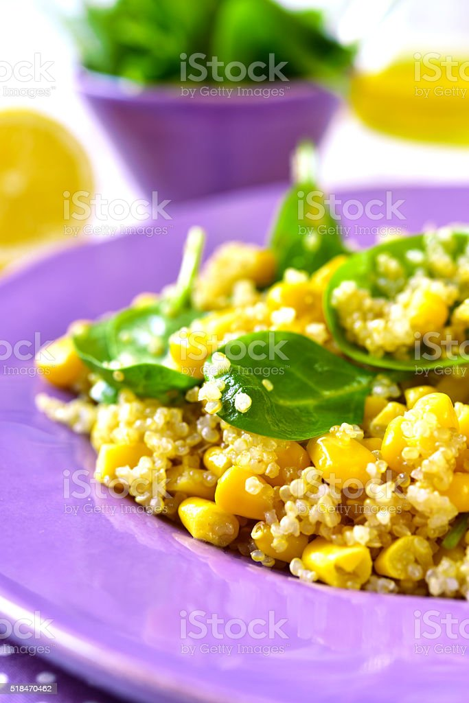 Quinoa salad with spinach and sweet corn. stock photo