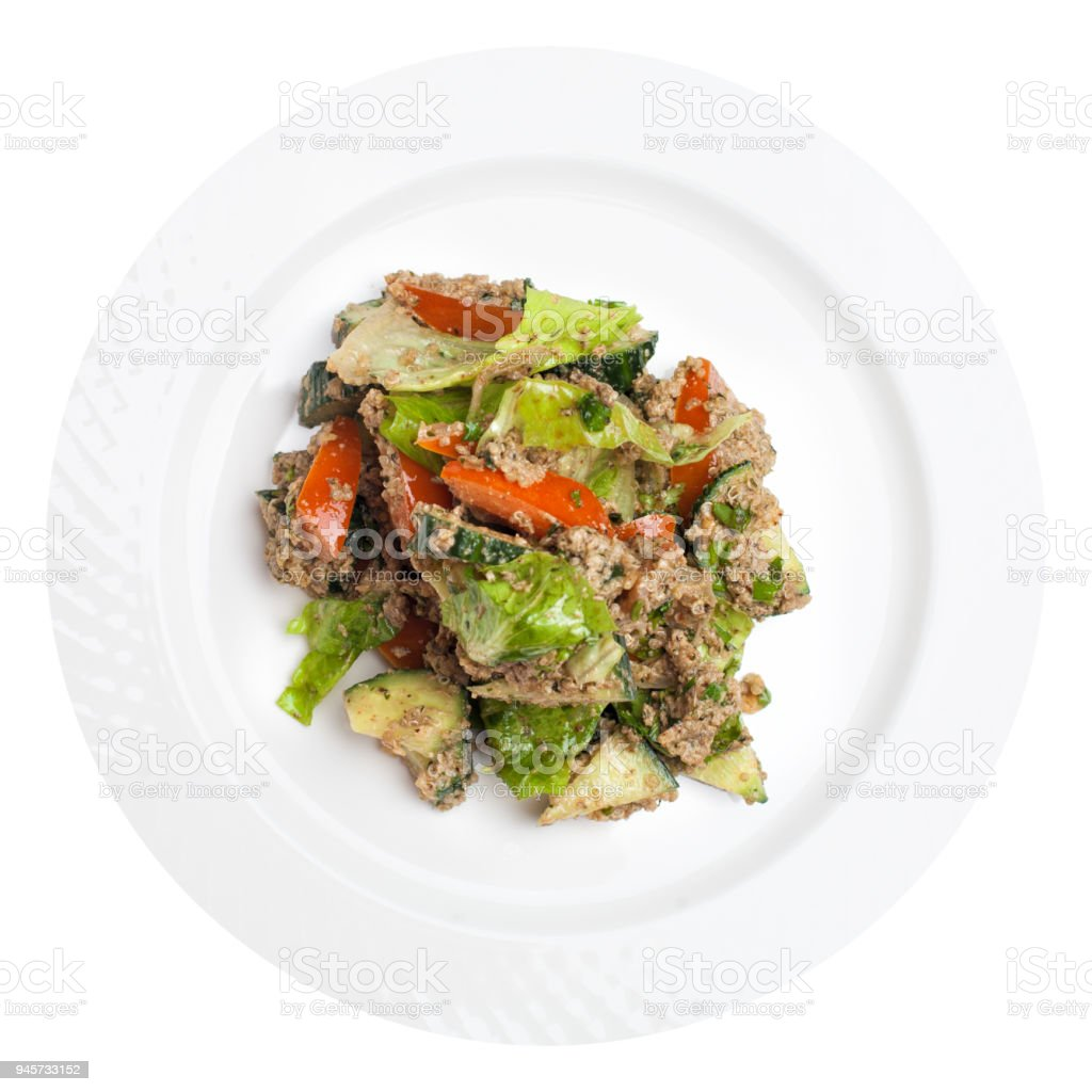 Quinoa salad with vegetables mix isolated on white, top view. Superfoods concept stock photo