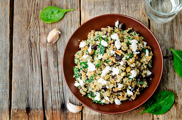 quinoa spinach eggplant feta salad - quinoa stock photos and pictures