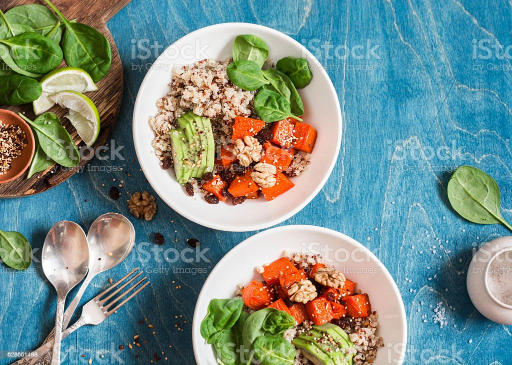 Quinoa with pumpkin, spinach and avocado. Healthy quinoa bowl. stock photo