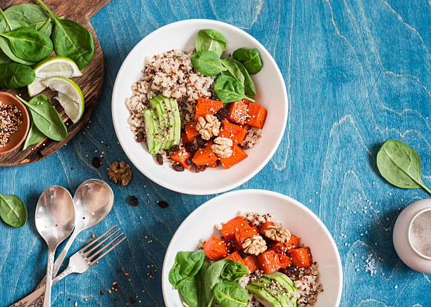 quinoa with pumpkin, spinach and avocado. healthy quinoa bowl. - quinoa stock photos and pictures