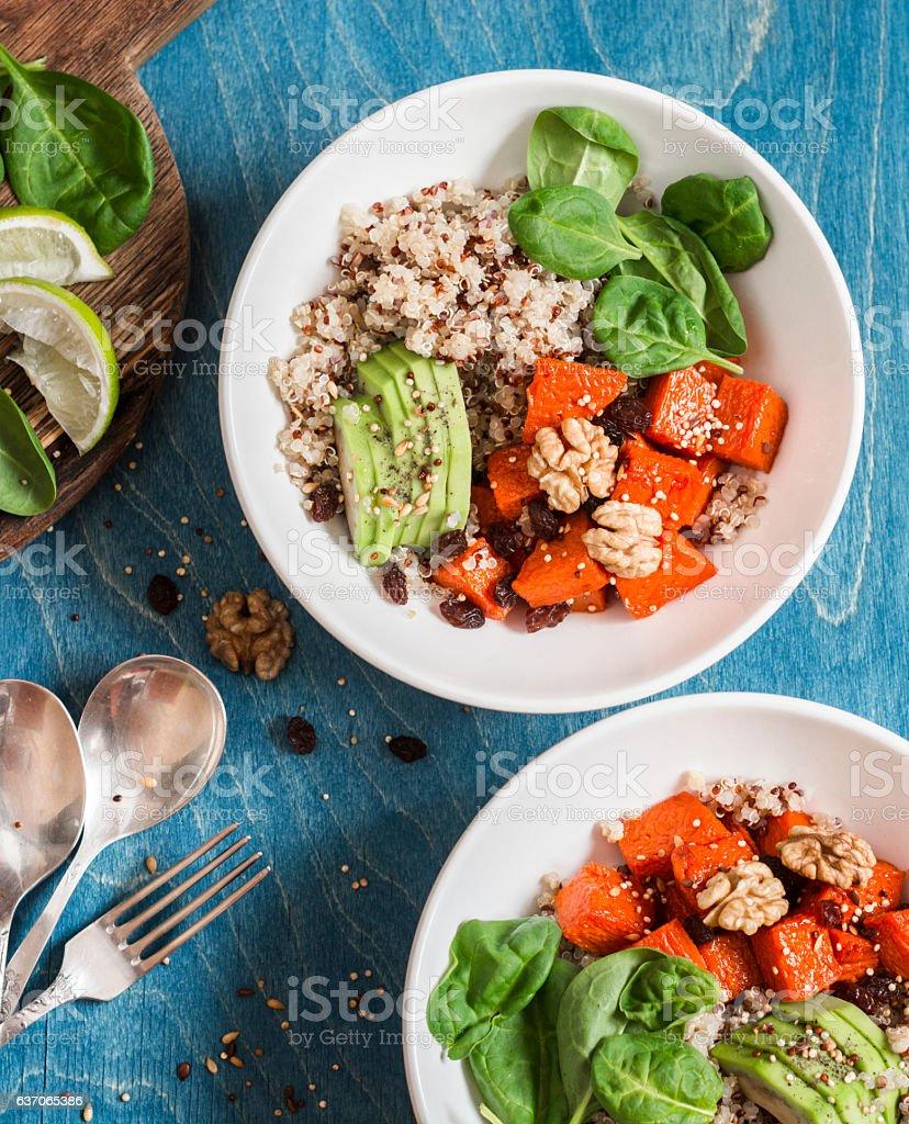 Quinoa with pumpkin, spinach and avocado. Healthy quinoa bowl - Photo