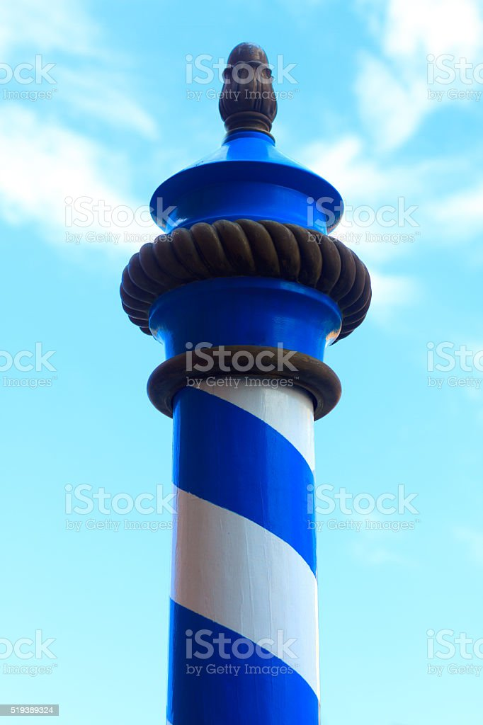 Quintessential Venetian Symbol: Blue and White Mooring Pole (Close-Up) stock photo