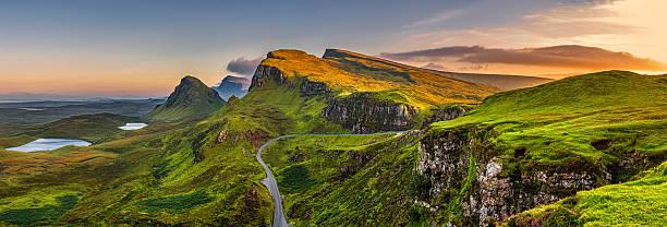 Quiraing mountains sunset at Isle of Skye, Scottland, United Kingdom Panorama of  Quiraing mountains sunset at Isle of Skye, Scottish highlands, United Kingdom isle of skye stock pictures, royalty-free photos & images
