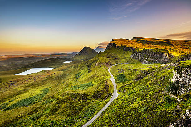 Quiraing mountains sunset Quiraing mountains sunset at Isle of Skye, Scottish highlands, United Kingdom isle of skye stock pictures, royalty-free photos & images