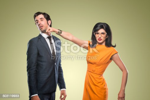 Quirky stylish woman throwing a punch at her lover.