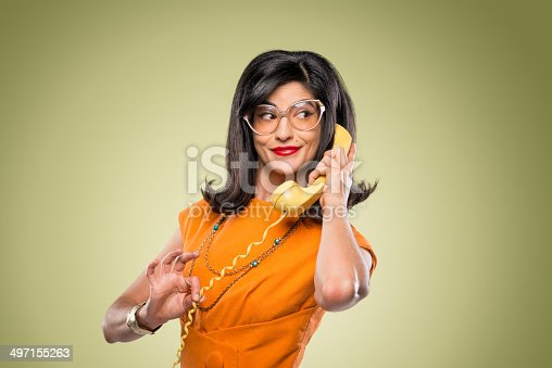 istock Quirky Stylish Woman With Vintage Telephone 497155263