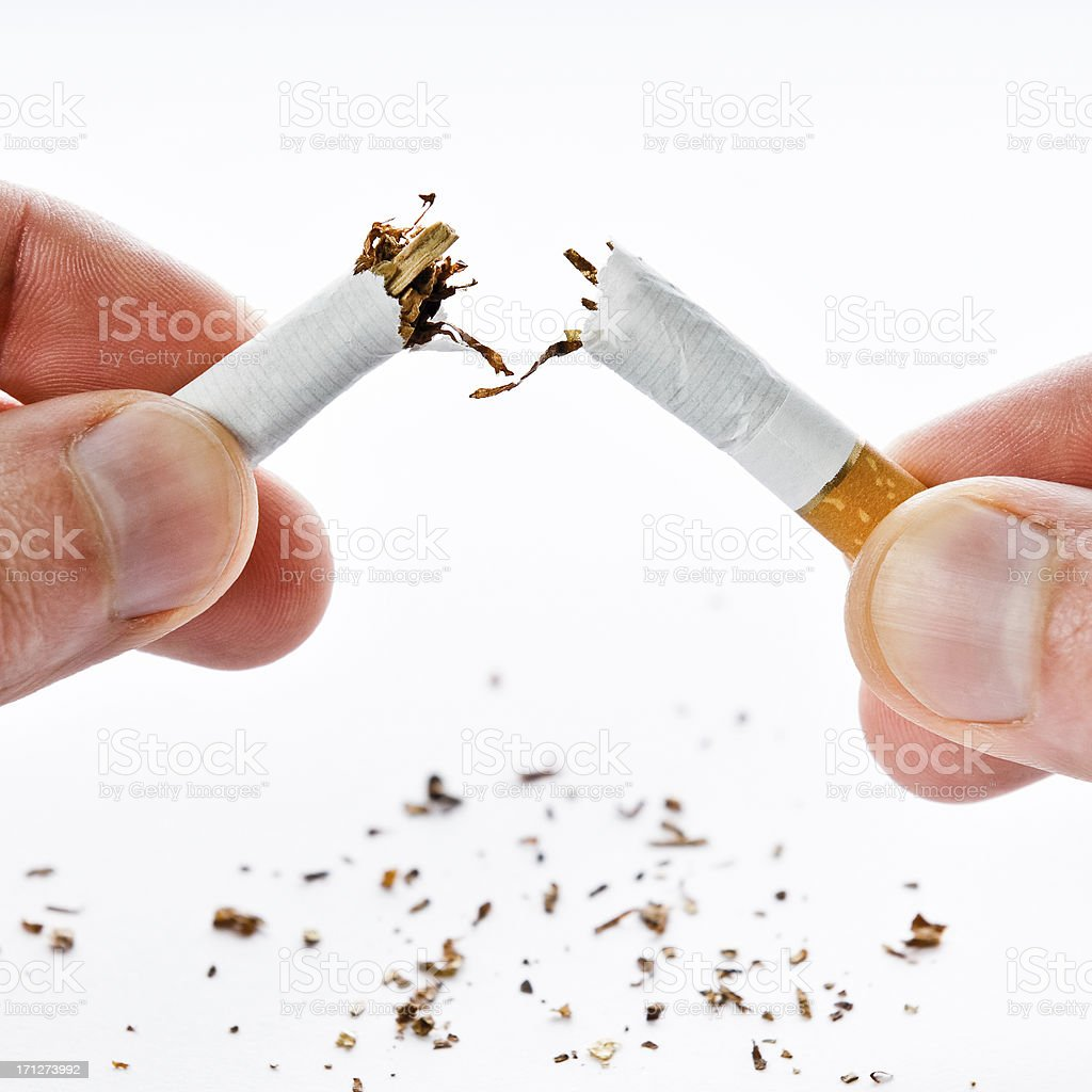 Quit smoking, cigarette broken in half, isolated on white stock photo