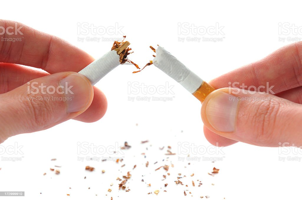 Quit smoking, cigarette broken in half, isolated on white royalty-free stock photo