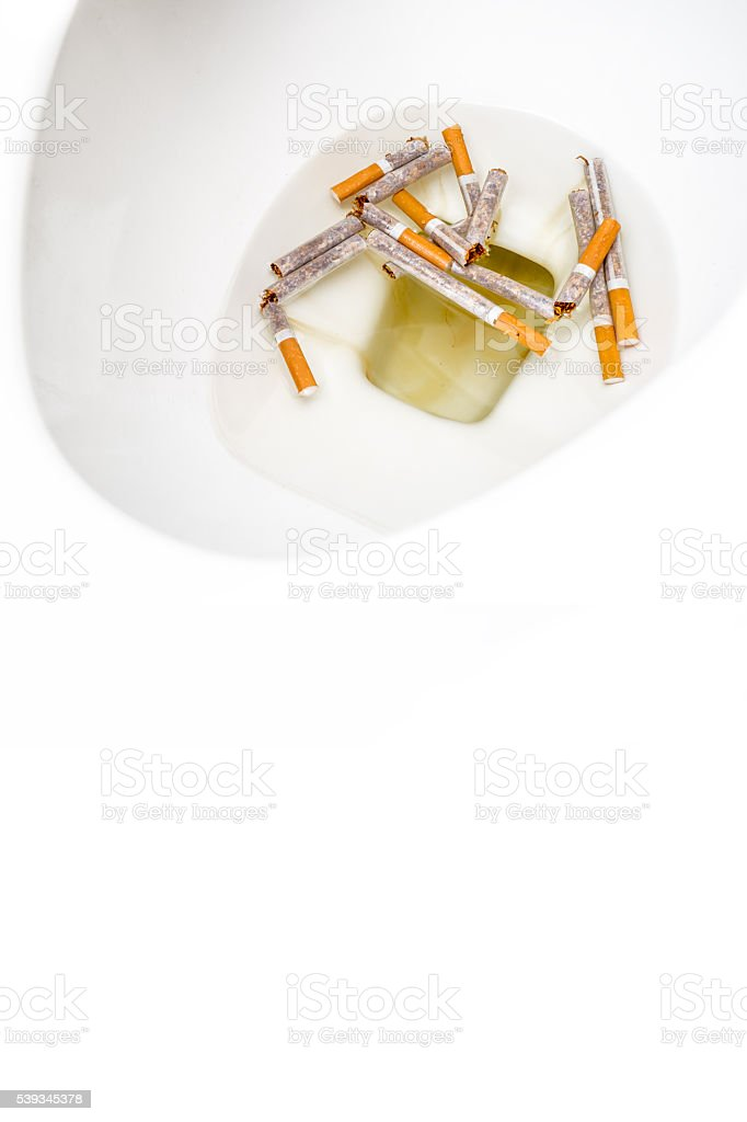 Quit Smoking : Cigarettes in the toilet stock photo