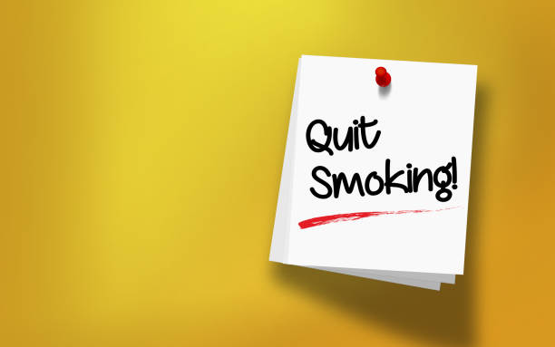 Quit Smoking Message Written On White Sticky Note Paper Quit Smoking message written on white sticky note paper attached with red push pin on yellow background. Realistic design with copy space. High resolution image to crop your design needs. stop smoking stock pictures, royalty-free photos & images