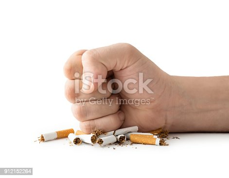 Man fist destroying cigarettes , isolated on white