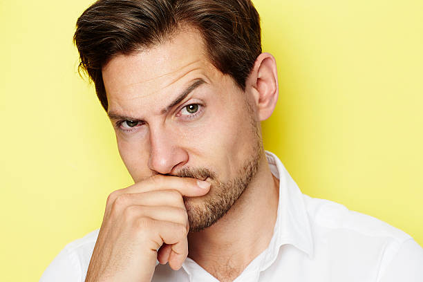 Quizzical guy Quizzical man raising eyebrow, portrait raised eyebrows stock pictures, royalty-free photos & images