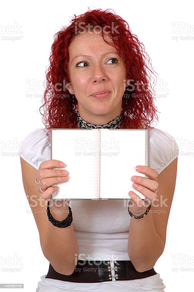 Quizzical woman with notebook royalty-free stock photo