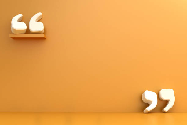 Quotation Marks against an orange wall stock photo