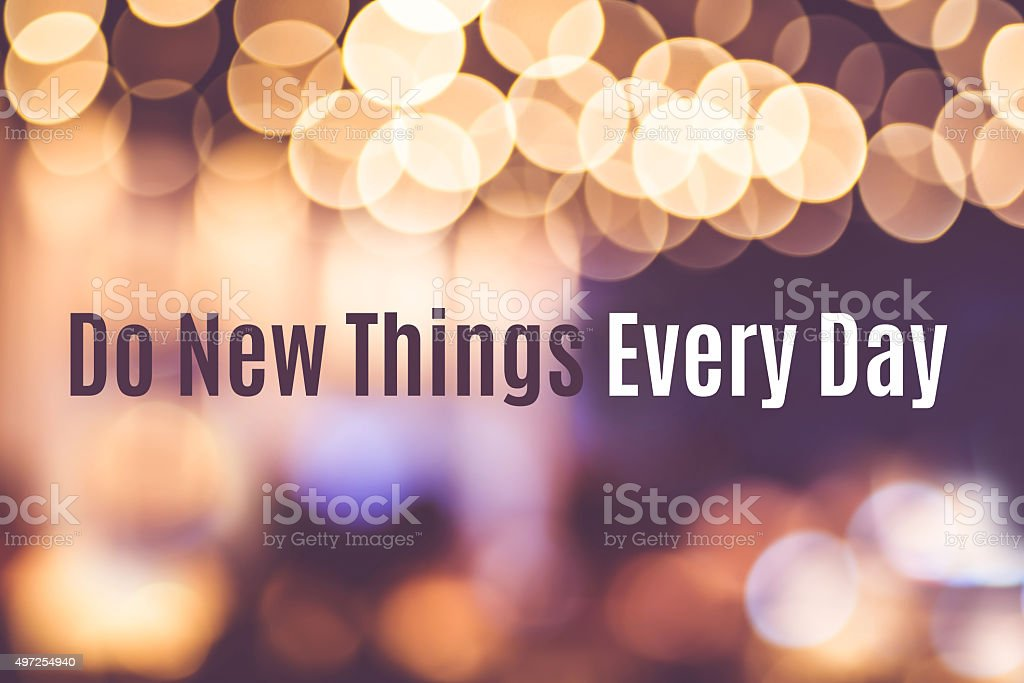 Quote : ' Do new things every day' with blur stock photo