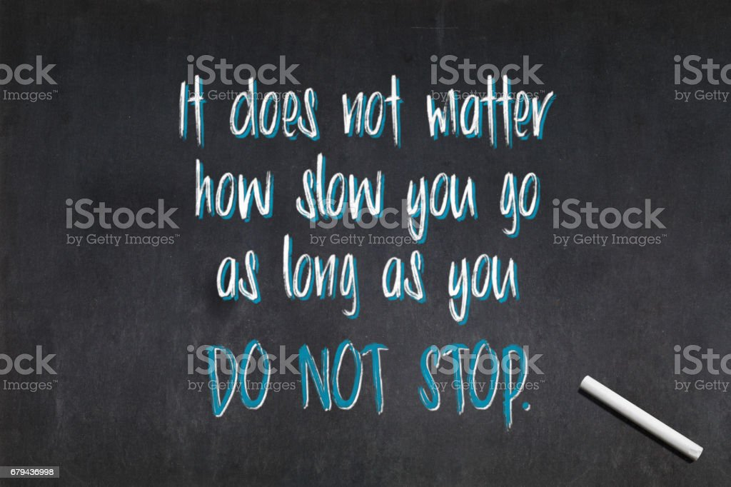 Quote from Confucius about not stopping royalty-free stock photo