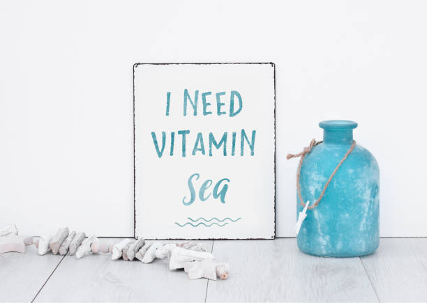 Quote text I need vitamin sea c with blue decoration text banner board on white isolated background wall grey wooden floor stock photo