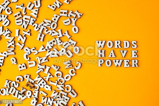 istock Quote WORDS HAVE POWER made out of wooden letters on bright yellow background. 1271673071