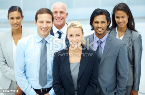 A group of successful and satisfied businesspeople looking upwards smiling