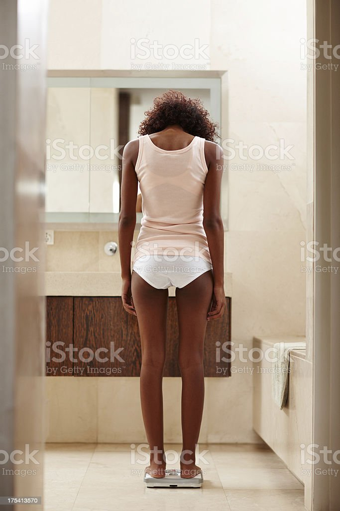 """""""Just a few more kilograms and I'll be happy"""" royalty-free stock photo"""