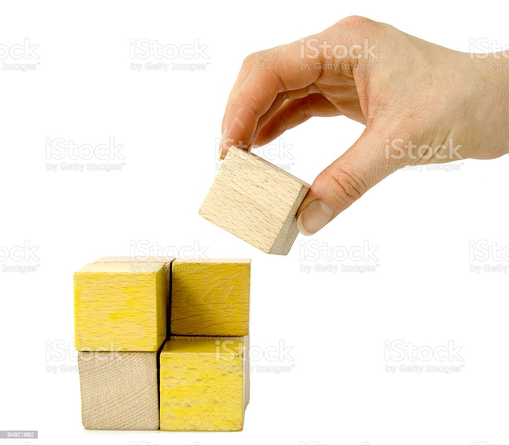 """let's build it"" or hand holding wooden block royalty-free stock photo"