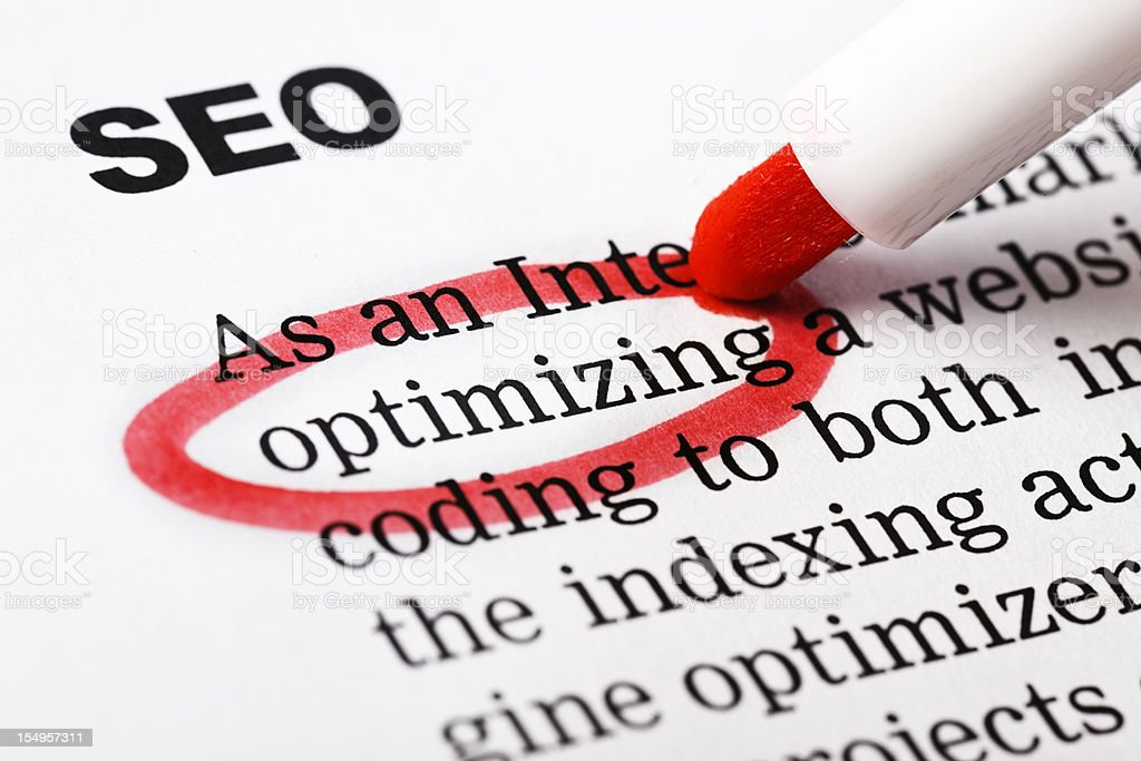"""optimizing"" highlighted in red under heading ""SEO"" on printed document royalty-free stock photo"