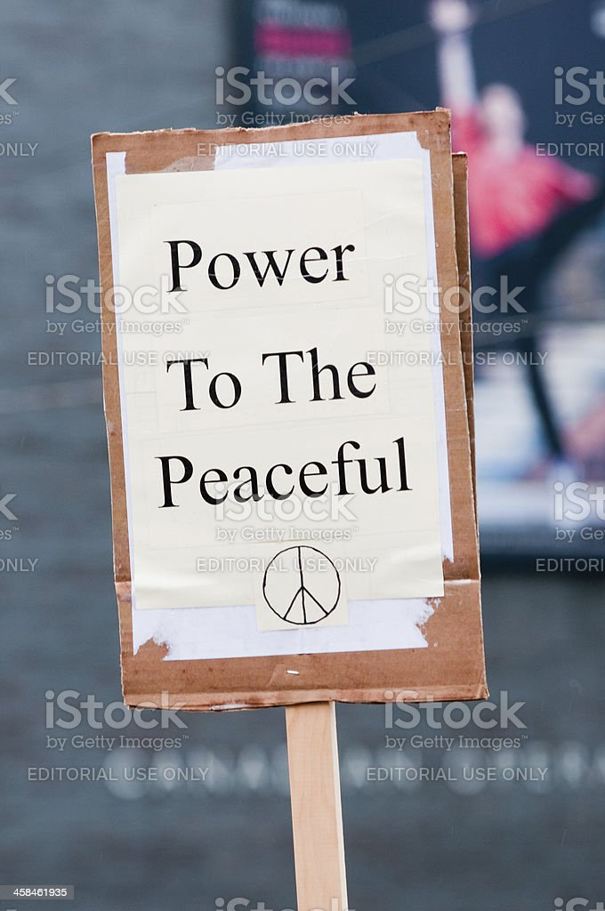 """Power to the Peaceful"" protest sign royalty-free stock photo"