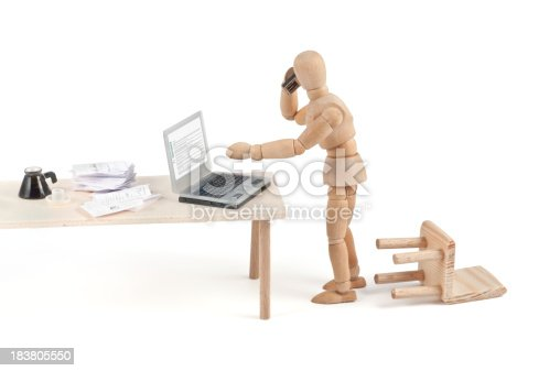 """istock """"what?"""" modern communication - wooden mannequin at work 183805550"""